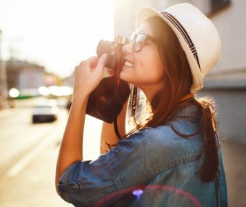 close-up-of-girl-taking-a-photo-in-the-city_1140-67